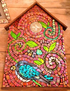 I found this wooden house shaped board at an estate sale and this is what happened!  Stained glass, beads, plates, millefiori, found object.